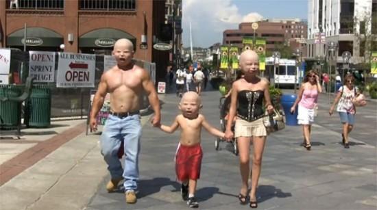 Giant Baby Heads Masks by Landon Meier