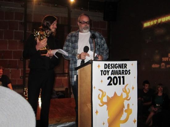 Frank Kozik presenting an award