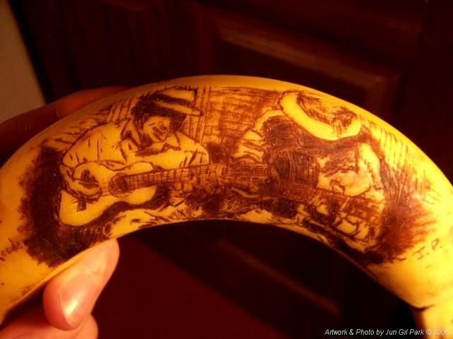 Dueling Latino Guitarists Banana by Jun Gil Park