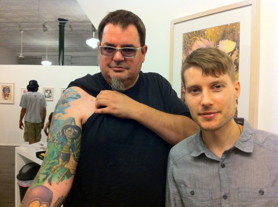 Ron and Nathan Jurevicius with tattoo of art