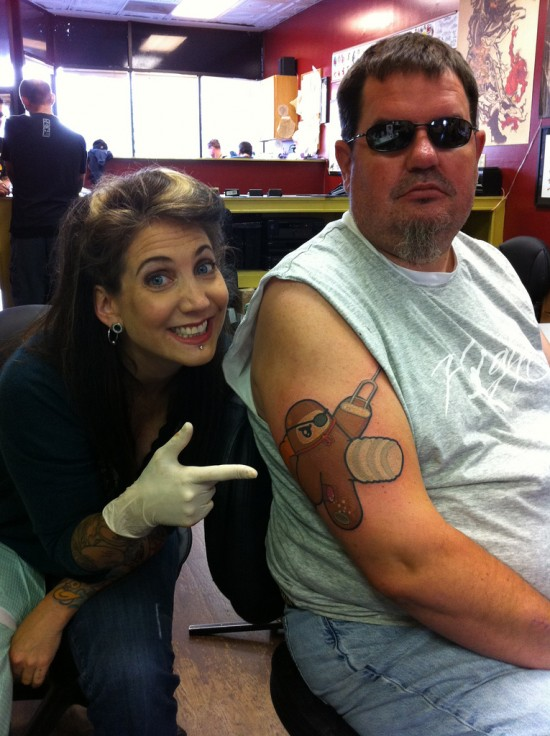 Hannah Aitchison and Ron with tattoo of art by Shawnimals