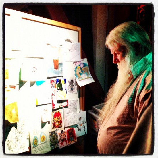Ron Turner checking out the affordable art wall.