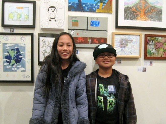"Kayla and Ryan Suavillo in front of Ryan's painting, ""Life of Minecraft""."