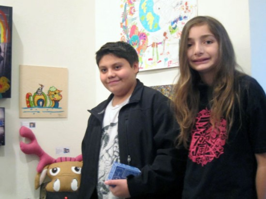 "Kids art: D-Rock with Cooper, in front of D-Rock's painting ""I am Horrible at Naming Things"""