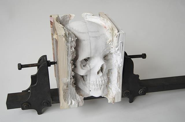Maskull Lasserre: Human Skull Carved Out of Software Manuals