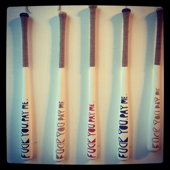 """Fuck You. Pay Me."" Seriously. Baseball bats photographed by @whitewallssf."