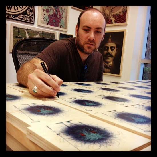 @jeffsotoart signing his latest batch of affordable prints on wood.