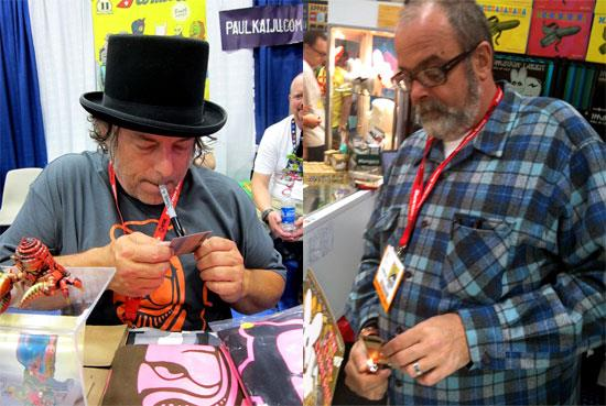 Paul Kaiju and Frank Kozik signing their Art Hustle cards.