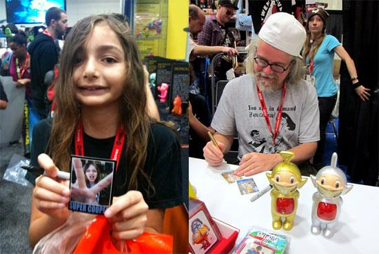 Super Cooper and Ron English signing their Art Hustle cards.