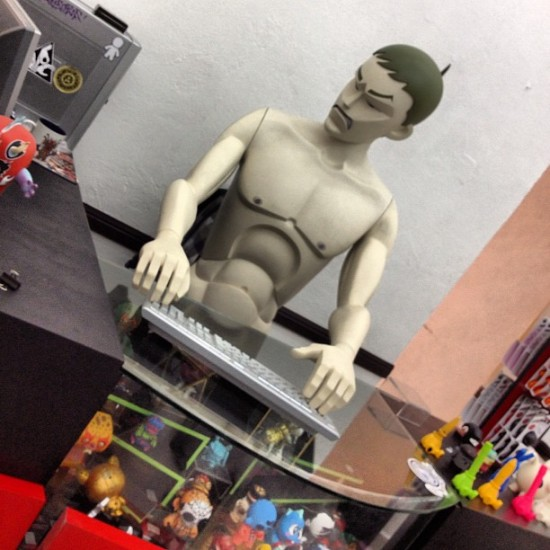 Coarse Toys running the toy art shop in Mexico. Photo by @vinyleschiles.