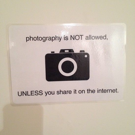 """Photography is NOT allowed UNLESS you share it on the Internet"". Nice. Photo by @lukechueh."