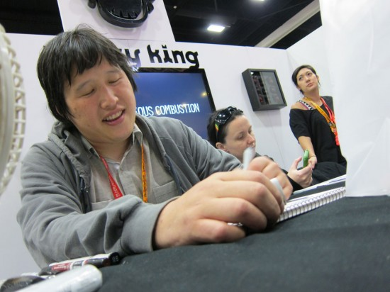 Luke Chueh signing at Munky King