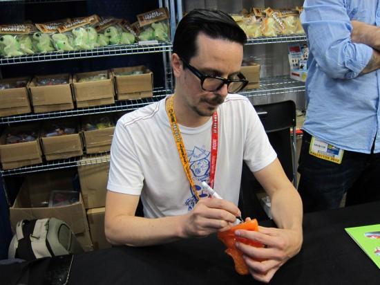 Tim Biskup signing orange Helper Dragon