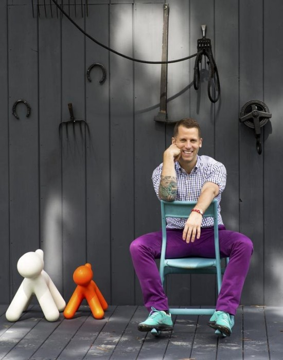 Bradford Shellhammer of Fab with Magis Puppy Chairs, photo by Trevor Tondro for the New York Times