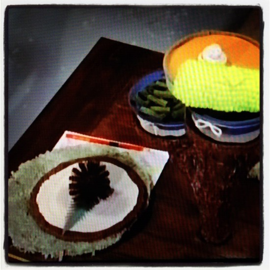 Dressing the table with a toilet brush and some felted green beans...