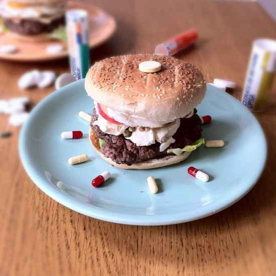 Dr. Burger. chopped beef steak (for protein). Fried egg (for protein). Cream cheese with aspirin (for calcium and headache). Apple (for vitamins). Sunflower seeds and pine nuts. Lettuce.
