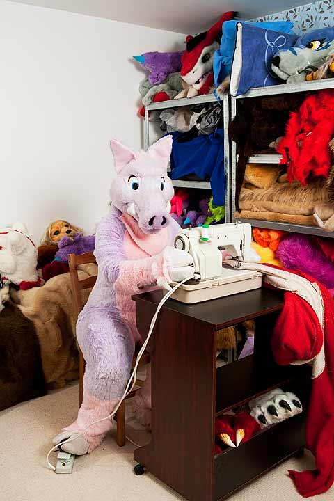 Broccoli, a pink boar works in fursuits for a living. Photograph © Tom Broadbent.