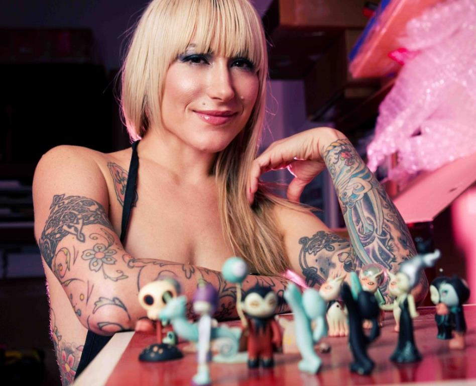 Tattoos inspired by art: Tara McPherson shows off her toys and tattoos (photo by Skin Ink).
