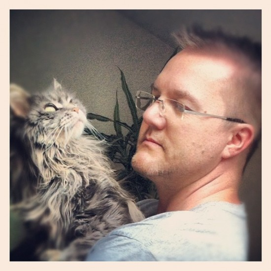 @VISEone in Germany with his sweet cat, Sally, who has cancer...
